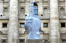 Italian artist unveils 20 foot middle finger to stock exchange