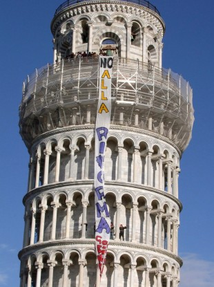 Italian students occupying the Leaning Tower of Pisa drape a banner reading 'No to Reform', protesting at proposals to rationalise university teaching.