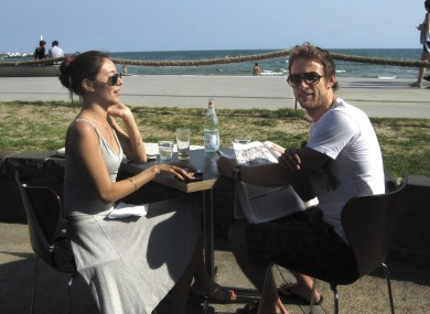 Brawn GP driver Jenson Button enjoys a quiet moment with his girlfriend Jessica Michibata at Melbourne's St Kilda beach earlier.