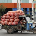 Vendors carry bags of onions on an extraordinary-looking modified truck to sell at a local bazaar in Mandalay in central Myanmar. (AP Photo/Khin Maung Win)