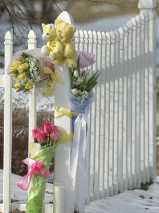 File photo of flowers left outside the home of the Prince family in Massachusetts.