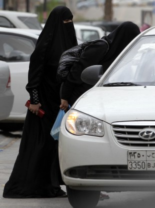 Saudi women board a taxi in Riyadh, Saudi Arabia