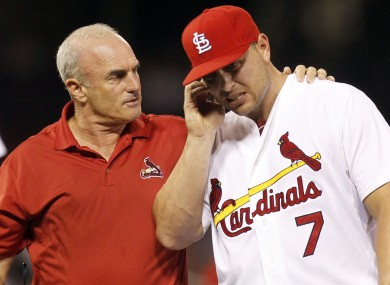 St Louis Cardinals trainer Barry Weinberg helps Cardinals left fielder Matt Holliday.