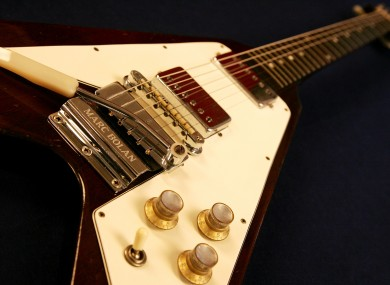 A Gibson Flying V electric guitar used by late rock musician Marc Bolan.