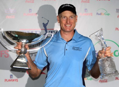 Jim Furyk celebrates with the FedEx Cup and the Tour Championship trophy last year.