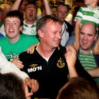 Manager Michael O'Neill is surrounded by fans at the airport.
