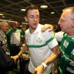 Billy Dennehy celebrates with a fan.