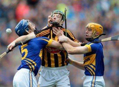 Tipperary's John O'Keefe and Shane McGrath tackle Henry Shefflin of Kilkenny.