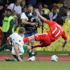 Richard Dunne tackles Yuri Zhirkov of Russia on his way to cutting his face.