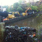 A massive amount of debris has to be moved from the River Dodder by machine. Image: Frank Gallen