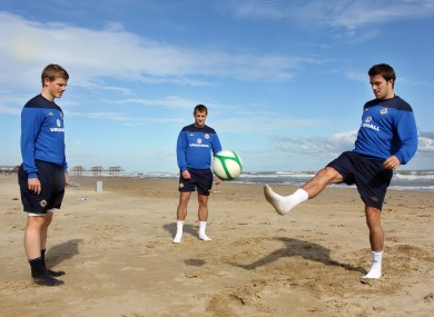 Northern Ireland's Andrew Little, Niall McGinn and Johnny Gorman play keepy-uppy on the beach in Pescara yesterday. Northern Ireland take on Italy tonight.