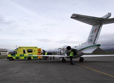 A patient is transferred during one of the air ambulance missions at Casement Aerodrome.