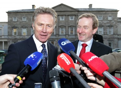 Eamonn Coghlan with Taoiseach Enda Kenny outside Leinster House today