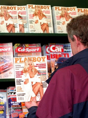 A Dublin man peruses the first issue of Playboy released for sale in 1995. The magazine had been banned in Ireland before then.