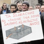 Tom Wallace from Connemara with his artist's impression of a septic tank at a protest in January 2012 on the proposed inspection fee - some argued it was an attack on rural householders. (Pic: Laura Hutton/Photocall Ireland)
