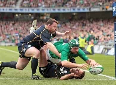Ireland's Rory Best scores a try despite the attentions of Mike Blair and Allan Jacobsen.