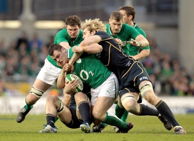 Richie Gray and David Denton look to take down Cian Healy.