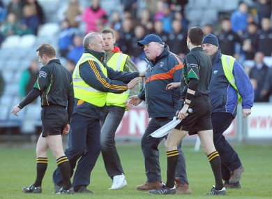 Armagh's assistant manager Paul Grimley confronts referee Michael Duffy after the game between Laois and Armagh.