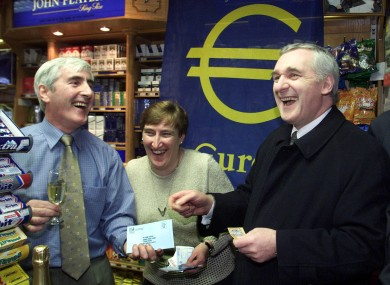 Then Taoiseach Bertie Ahern having a laugh with Jim and Marian O'Neill at their newsagents shop where he spent his first euro on 1 January 2002 after the changeover from punts.