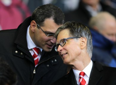 Comolli, left, talks to Liverpool's principal owner John Henry.