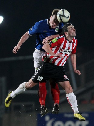 Farren competes against Linfield's Albert Watson during the Setanta Sports Cup quarter-final.