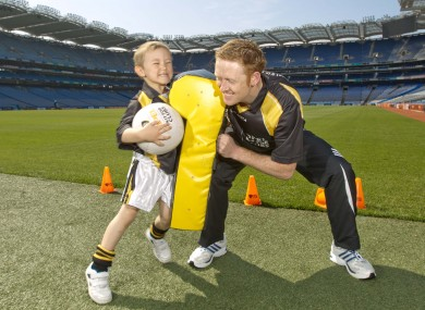 Colm Cooper squares up to four-year-old Derry Finlay at the launch of Opel's Kit for Clubs scheme earlier this week.