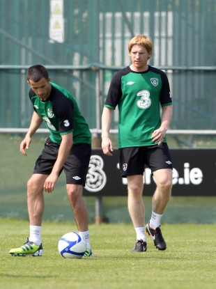 McShane (right) with Keith Fahey in training today.