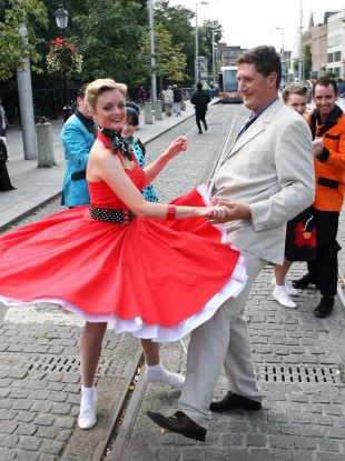 Former communications minister Eamon Ryan joins Nicola Hanlon, a 1950s dancehall hopper, during celebrations marking the 50th Anniversary of Prize Bonds in 2007.