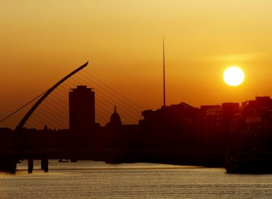 The sun sets over the river Liffey in Dublin