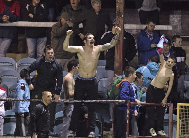Local heroes: Drogheda fans roar on their side from the United Park terraces.