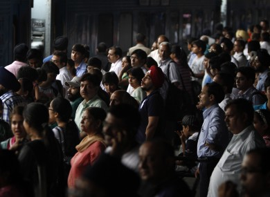 Stranded passengers wait for power to be restored at New Delhi railway station.
