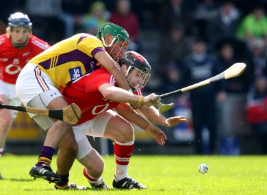 Wexford's Harry Kehoe battles with Paudie O'Sullivan of Cork