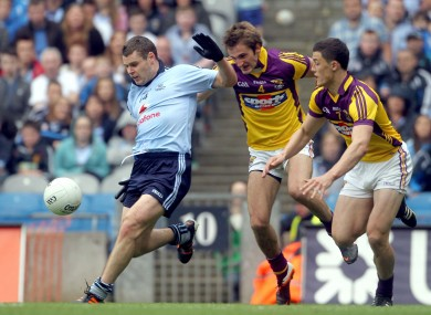 Dublin's Kevin McManamon with Brian Malone and Lee Chin of Wexford.