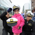 Seven-year-old Yasmine Dincbudak from Tallaght with sailors from Ecuador Israel Paredes and Franks Santos. (Sasko Lazarov/Photocall Ireland)