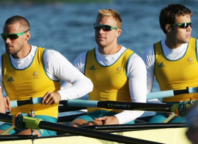 Australia's Joshua Booth, centre, with teammates Matthew Ryan, left and Thomas Swann.