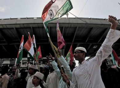 Indian Muslim youths celebrate after the judgement of the death sentence in May 2010