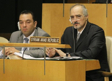 Syria's UN Ambassador Bashar Ja'afari, right, listens to speakers during a meeting of the United Nations General Assembly at the United Nations Friday, Aug. 3, 2012