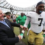 An Taoiseach Enda Kenny greets Notre Dame player Stephon Tuitt with a friendly box. ©INPHO/Cathal Noonan