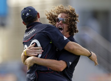 Defending champs: England's Ryan Sidebottom hugs teammate Tim Bresnan during the 2010 World T20.