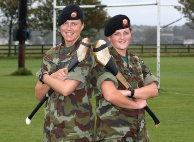 Corporal Gemma O'Connor (Cork), left, pictured with Private Shelly Keogh (Wexford). Both soldiers will be representing their counties in the Camogie All-Ireland this year.