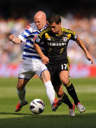 Queens Park Rangers' Andrew Johnson (right) and Chelsea's Eden Hazard.
