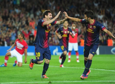 There is no falling out between Barcelona's Lionel Messi and David Villa according to their coach.