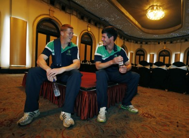 Ireland's cricketers Kevin O'Brien, left, and George Dockerell wait in the team hotel.