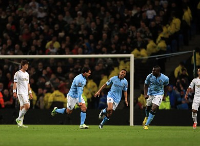 Tevez scores for City.