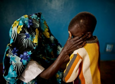 A victim of mass rape and her son in the town of Fizi, Democratic Republic of Congo (DRC) on Sunday, Feb. 20, 2011.
