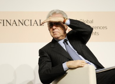 Italian premier Mario Monti at a meeting in Milan today