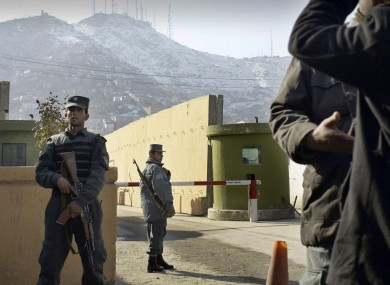 File photo: Afghan police officers stand guard outside of Kabul police headquarters, where a an American contractor was killed, in Kabul, Afghanistan.