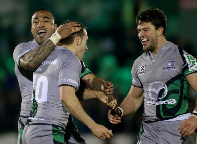 Vainikolo and Poolman celebrate with Parks after his late d