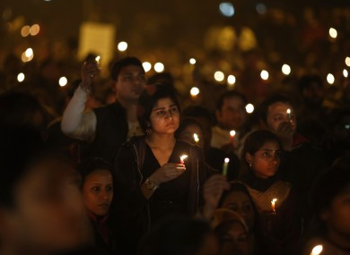 People hold candles at a vigil on Saturday to mourn the death of the 23-year-old medical student
