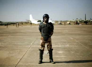 A Mali special forces soldier stands guard at Banako's airport on Wednesday